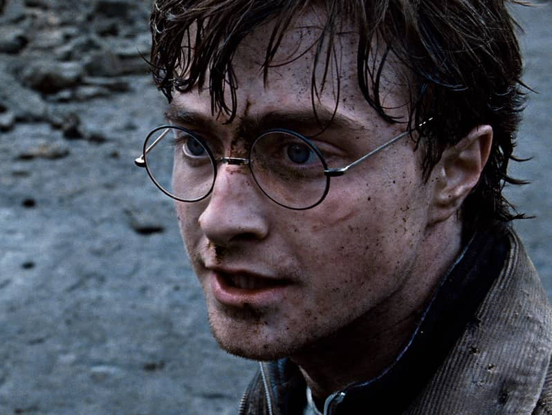 Daniel Radcliffe as Harry Potter.