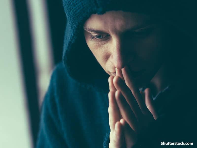 Man Sad, praying
