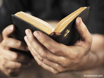 christian-man-reading-bible-prayer-hands