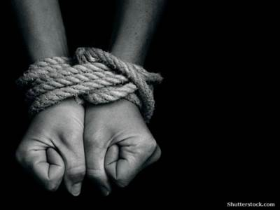 Hands wrapped in rope