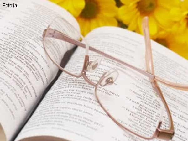 Open book and reading glasses