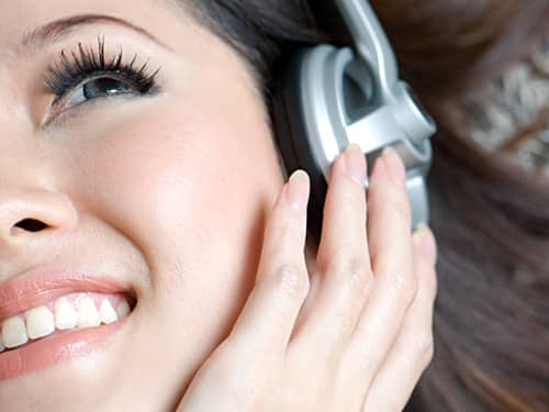 Smiling woman lstening to music