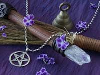 Purple cloth, pentagrams, broomstick, crystal wand, bell
