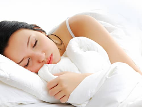 Woman sleeping on white pillow