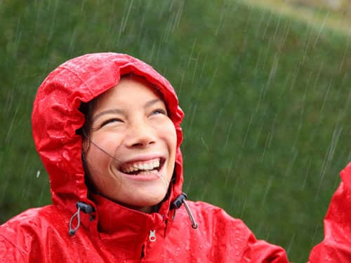 Woman smiling in the rain