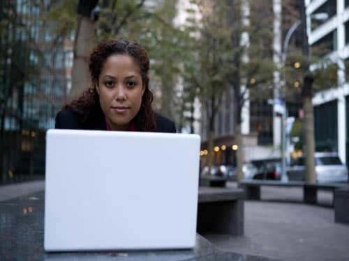 Woman on laptop in the city