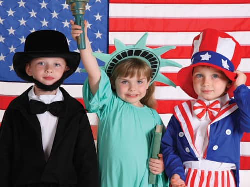 Kids in patriotic costumes - Abe Lincoln, Statue of Liberty, Uncle Sam