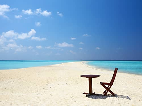 Table and chair on beach
