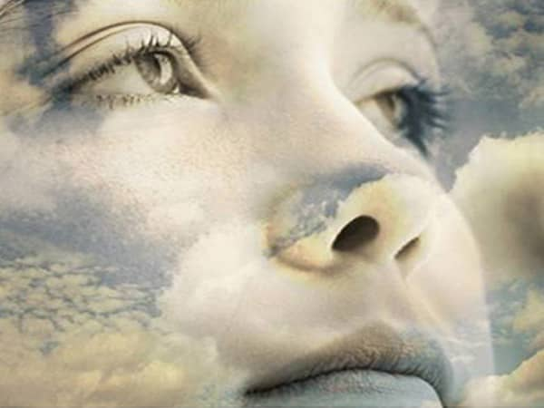 Womans Face in Clouds