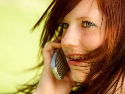 Redheaded woman on cell phone