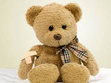 teddy bear with bandaid and tie