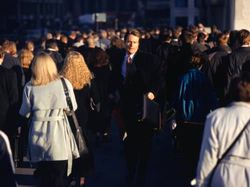 Man walking through large crowd of people