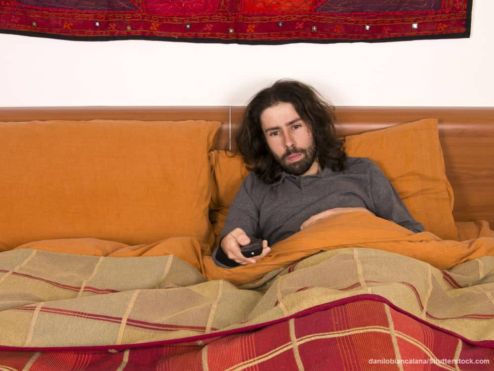 Man Watching TV in Bed