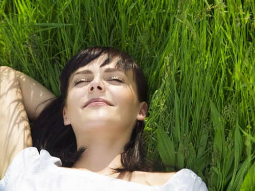 Woman resting in grass
