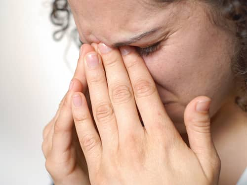 Woman with sinus pain