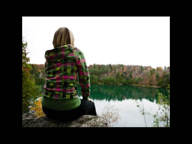 Girl looking at pond