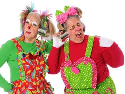 Two female clowns laughing telephone