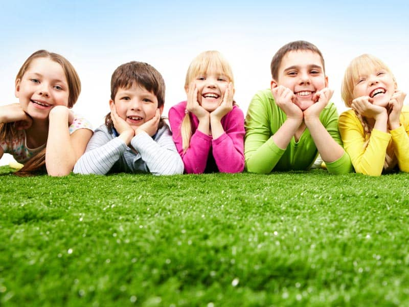 children-friends-on-grass