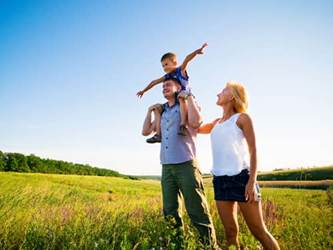 Healthy family walking in a field