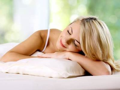 Woman resting on pillow