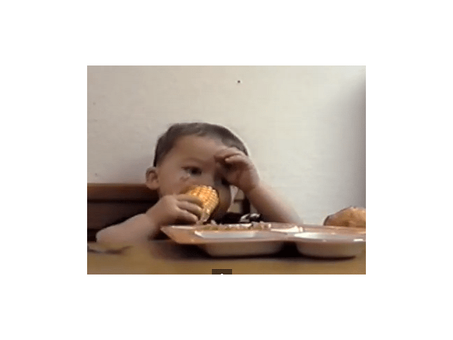 Little Boy Sneaks Food While Pretending to Pray