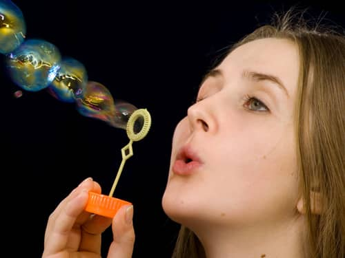 Girl blows bubbles