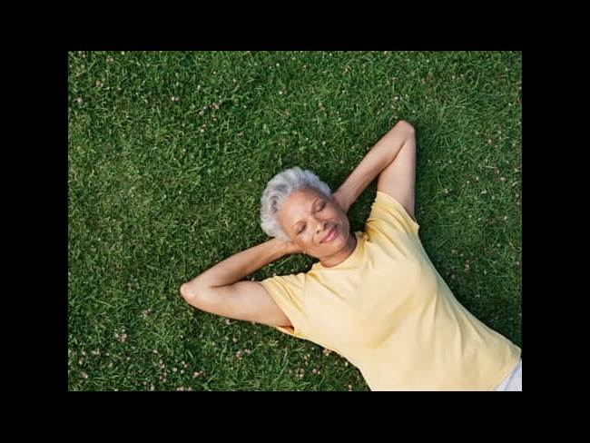 Woman Relaxes on Grass