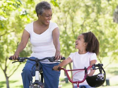 Grandmother and child riding a bike