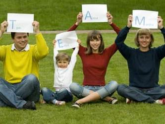 Family spelling out TEAM
