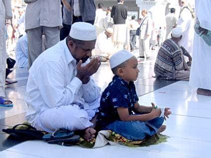 Muslim man and boy praying