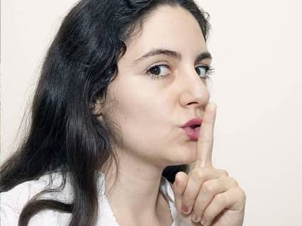 Black-haired woman requesting silence