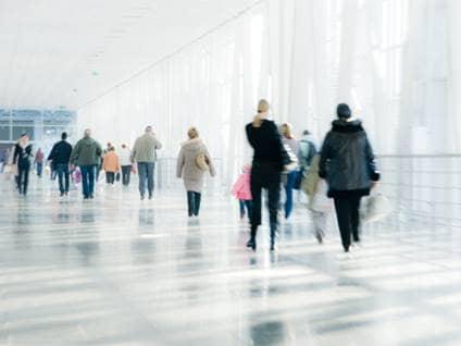 People walking down a corridor