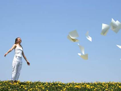 Woman letting go of papers
