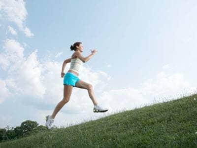 Woman sprinting uphill