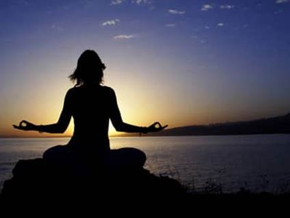 Sitting and watching the sunset, meditating.