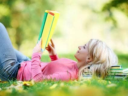 Woman reading in a field