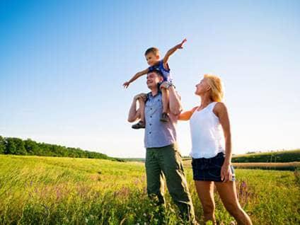 Healthy family walking in a field