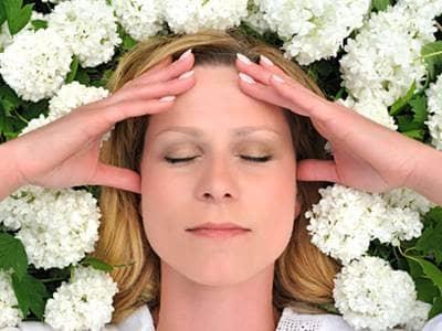 Woman relaxing among flowers