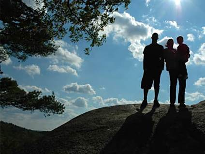 Silhouette of a family on a hill