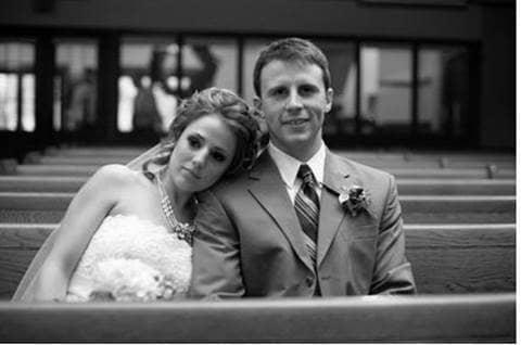 Erika and husband Reuben on their wedding day