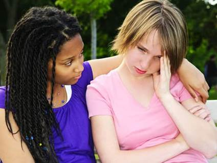 Young woman offering support to a grieving friend