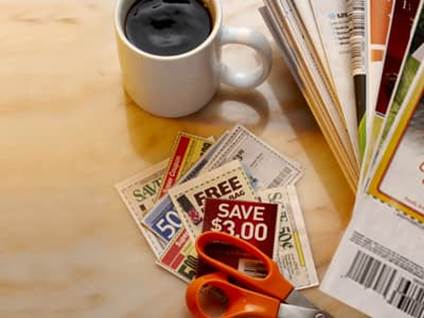 clipped coupons with scissors