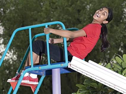Laughing child on slide